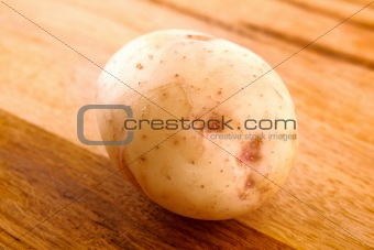 Potato on wooden surface