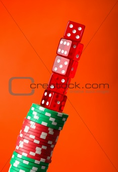 Casino chips and cards against red background