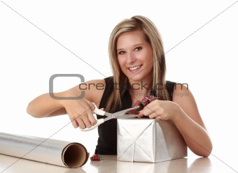 cute woman wrapping a xmas gift