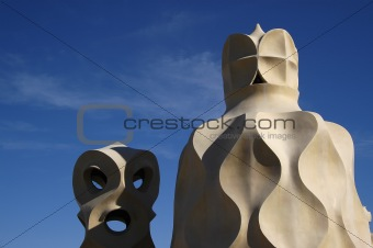 Face shaped chimneys on Gaudi Casa Pedrera
