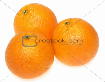 three oranges on white background