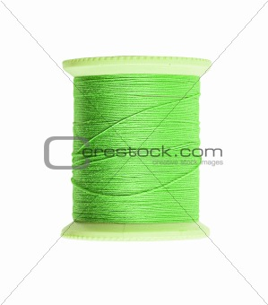Bright green thread isolated on white