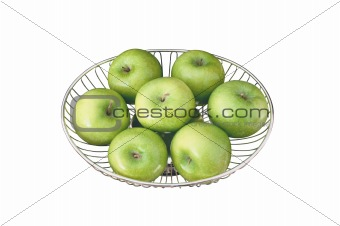 close up of green apples on plate isolated on white background