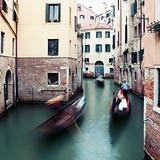 "Motion-blurred traditional ""gondola"" boats in Venice, Italy"