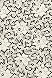 White textile with stylized flowers