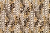 Textile with patterns of leopard and braids