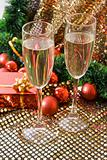 Two glasses with champagne and New Year decorations