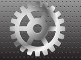 Realistic gear on a metal background with holes