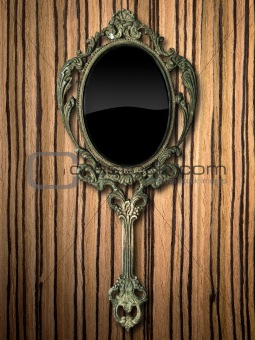 ancient hand mirror on zebrano Wood