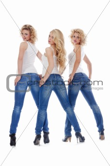 three young women in casual clothing standing,  looking - isolated on white