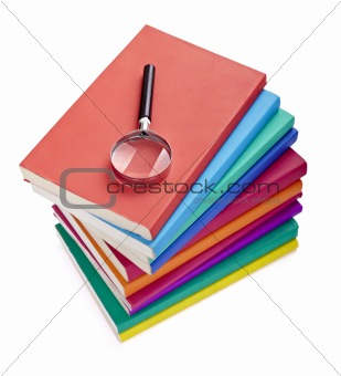 colorful books knowledge education  wisdom literature magnifying