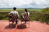 Couple on balcony of safari lodge