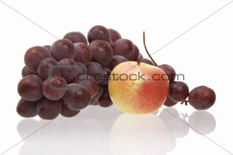 Apple and grapes on a white background