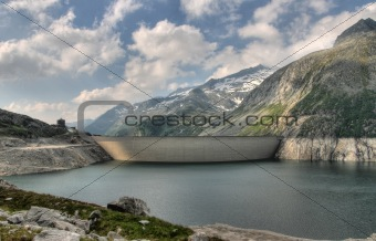 Alps mountains and dam wall