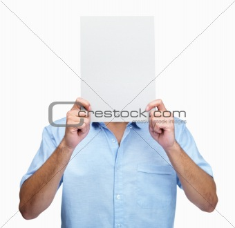 Young guy hiding behind an empty billboard