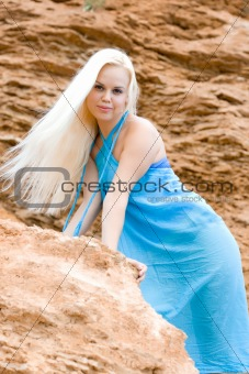 blond woman among rocks