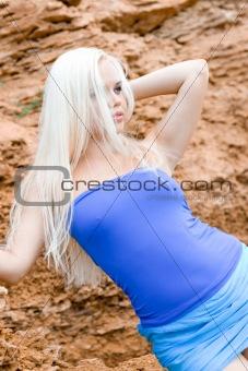 blond woman among rocks