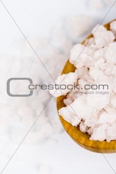 bath salt on a wooden spoon