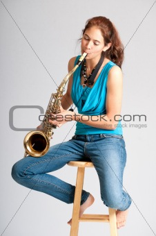 Beautiful young woman saxophone player
