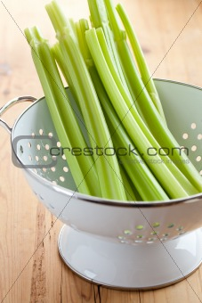 green celery sticks in colander