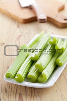 green celery sticks on kitchen table