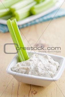 green celery sticks with tasty dip