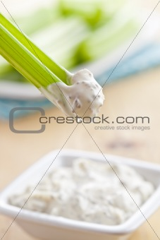 green celery sticks with tasty dip