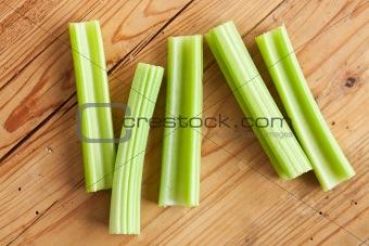 green celery sticks on kitchen table