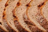 Texture of a sliced fresh dark bread