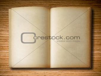 old book open on oak wood background