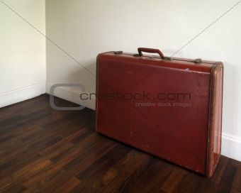 Old Suitcase on wood floor