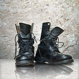 old black boot on white marble