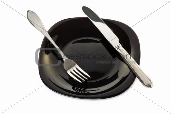 Black plate with fork and knife