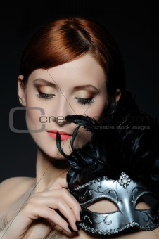 Beautiful woman with perfect party make-up in carnival mask
