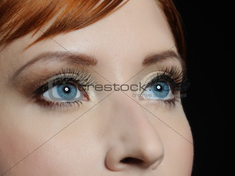 Beautiful macro shot of blue eyes with long lashes and make-up i