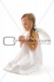 Little angel girl praying