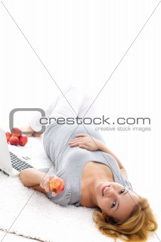 Pregnant woman relaxing on the floor