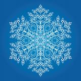 Detailed snowflake on light blue background