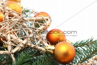 Arrangement with orange Christmas ornaments and gold stars