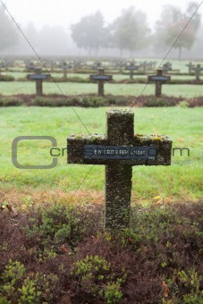 crosses at cemetery in autumn mist