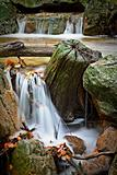 small waterfall in autumn river