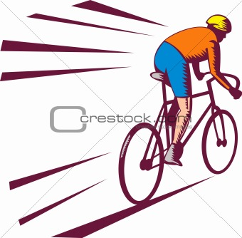 Cyclist racing on bicycle