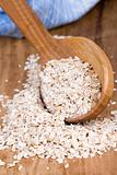 oat flakes in wooden spoon