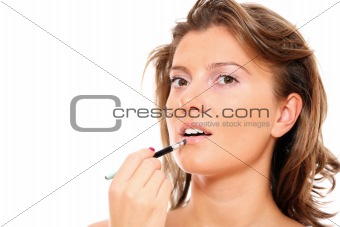 Beautiful woman putting on makeup