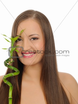 Beautiful spa woman with long healthy hair and pure skin with a