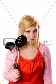 young housewife with kitchen utensil