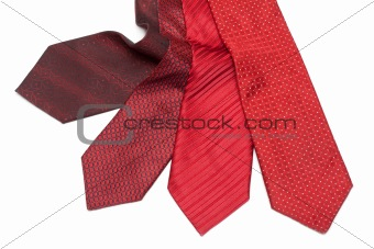 Four male ties, red and crimson