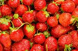 Lots of strawberries arranged as the background
