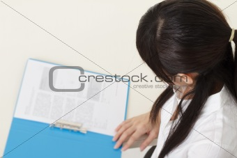Business woman reading report