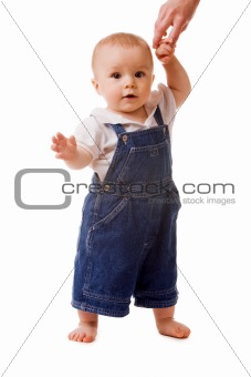 Small child in jeans with mom's hand